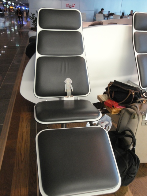 Flat Ruthie at Frankfurt Airport enjoying the comfy chairs.