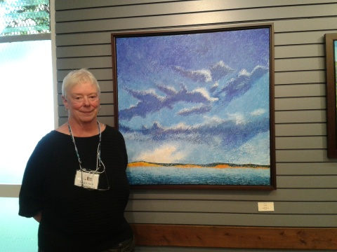 "Lea Price by one of her paintings called ""Clouds"""