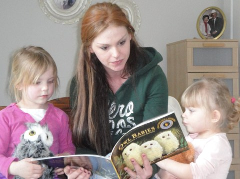 Second granddaughter reading to her daughter and niece