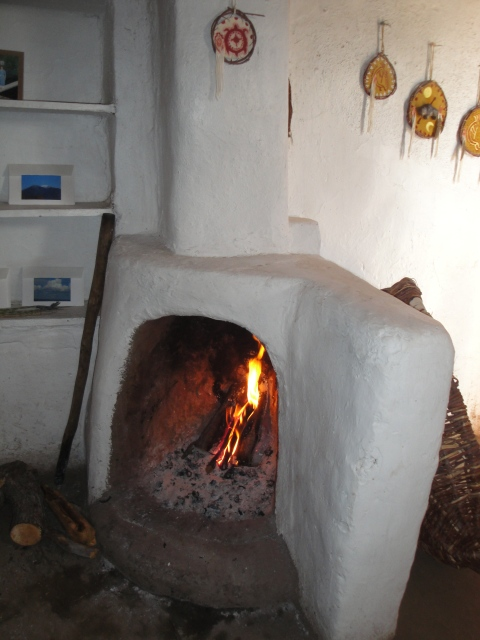 Welcoming fireplace inside an adobe home