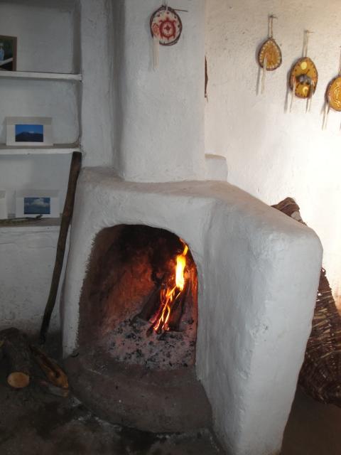 Welcoming fireplace inside an adobe home