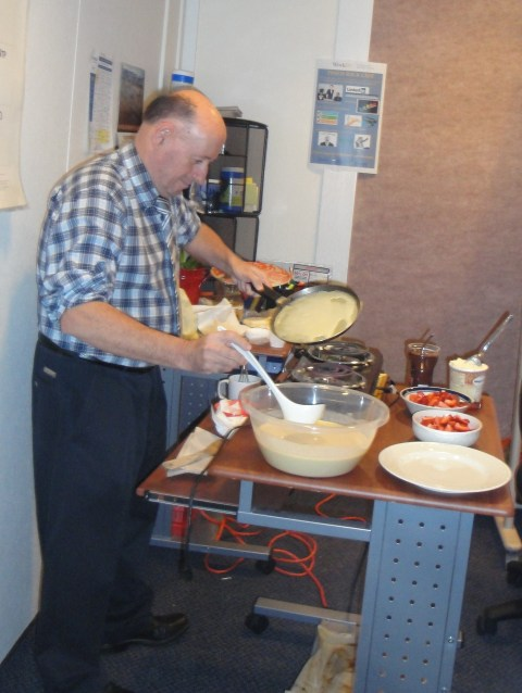A co-worker making crepes for everyone