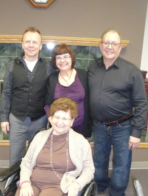Mom with me and my brothers November 2013, her 85th Birthday pary