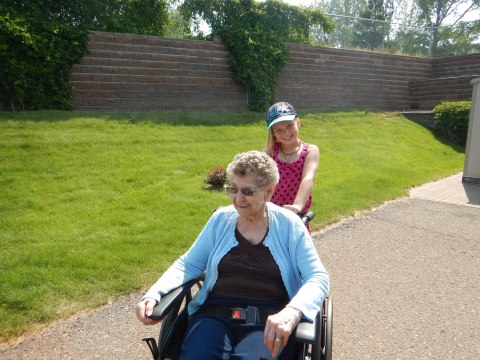 my other sweet great granddaughter giving her great great grandmother a ride in the garden