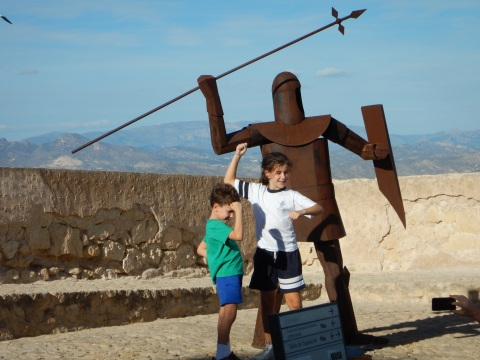 kids posing with a warrior while dad takes a picture