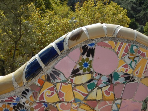 small peices of broken tiles and ceramics, often taken from demolition sites were used to create the mosaics in the park