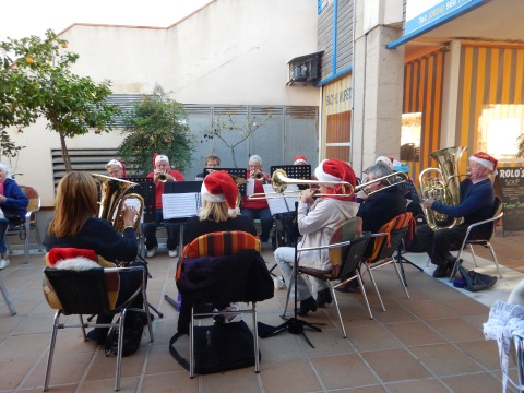 Brass band by a coffee shop