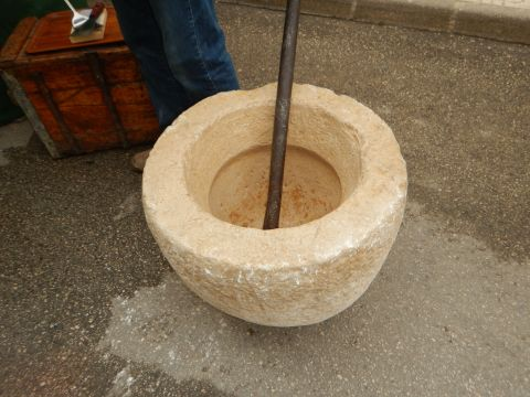 Mortar and pestle to mash sugar, almonds, zest of lemon and cinnamon for making almond candy called turron