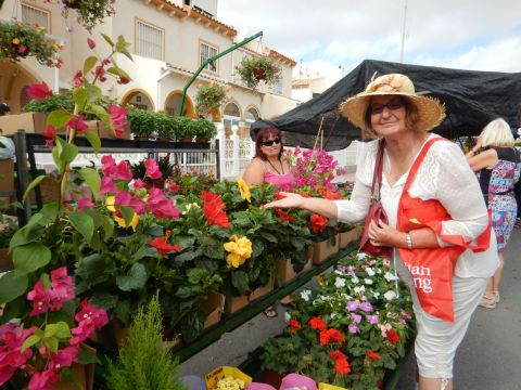 Jayne at the market, stopping to smell the flowers